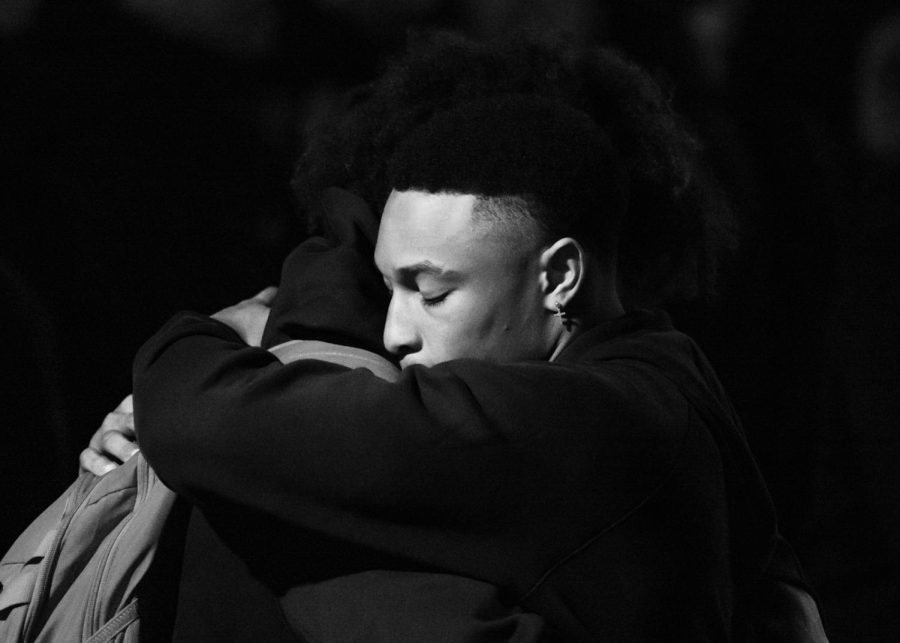 Two University of Utah students embrace at the candlelight vigil held on the A. Ray Olpin Union lawn on campus in celebration of the life of Aaron Lowe. Sept. 29, 2021 (Photo by Jack Gambassi   The Daily Utah Chronicle)