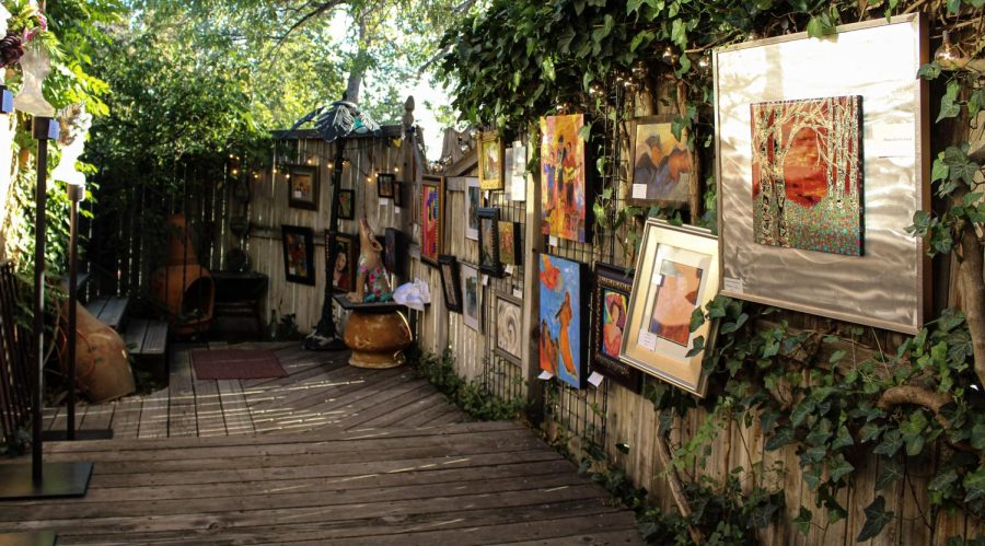Art is displayed along a fence for the Women in HeART event held at Pilars Garden in Salt Lake City, on Saturday, September 25, 2021 (Photo by Brooklyn Critchley   The Daily Utah Chronicle)