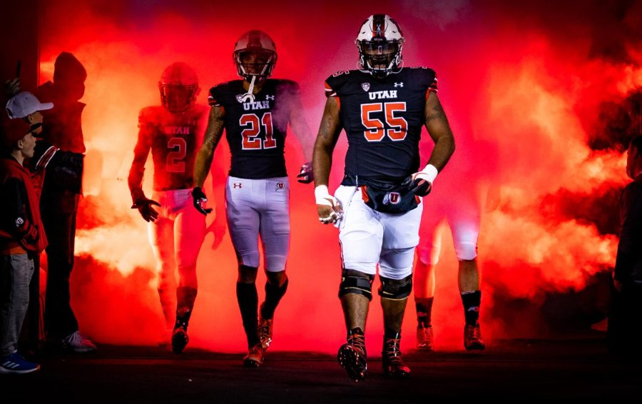 Junior center Nick Ford and junior wide receiver Solomon Enis walk out of the tunnel at the game against Arizona State football in Salt Lake City on Oct. 16, 2021. (Photo by Jonathan Wang | The Daily Utah Chronicle)