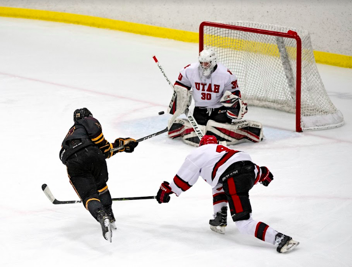 Sophomore goalie, Landon Anderson is positioned in the butterfly to block a shot headed towards him in a game against Arizona State University in Salt Lake City on October 23, 2021. (Photo by Kevin Cody | The Daily Utah Chronicle)