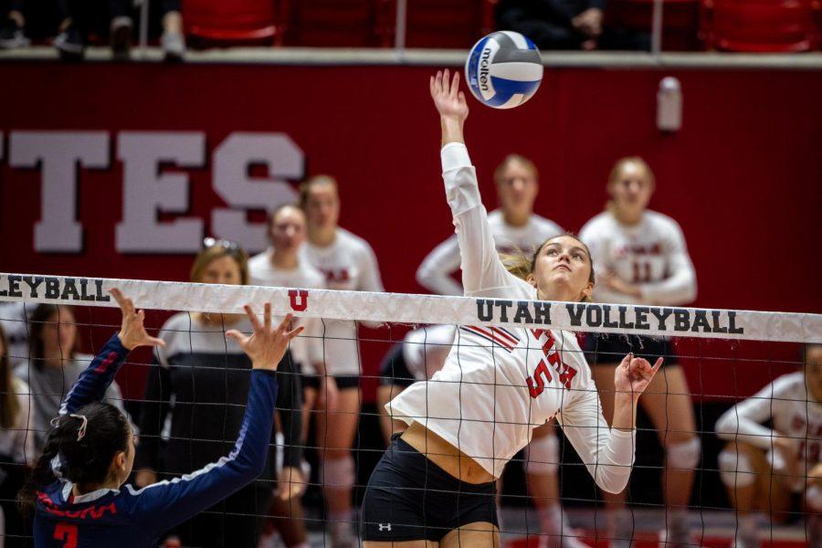 University of Utah middle blocker, Amelia Van Der Werff (#5), plays in a game against University of Arizona in Jon M. Huntsman Center, Salt Lake City, Utah, on Oct. 24, 2021. (Photo by Xiangyao Axe Tang | The Daily Utah Chronicle)