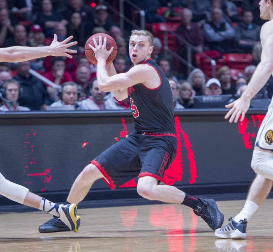 The University of Utah Mens Basketball Runnin Utes sophoomore Parker Van Dyke (5) evades the defense to pass the ball in a Pac-12 game vs the California Golden Bears at the Huntsman Center on Thursday, March 2, 2017 (Kiffer Creveling   The Daily Utah Chronicle)