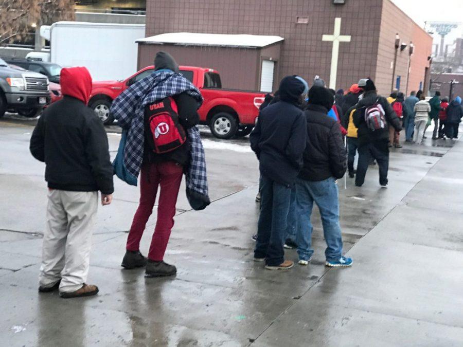 Displaced persons wait in line outside the St. Vincent de Paul Soup Kitchen on Jan. 8, 2017.