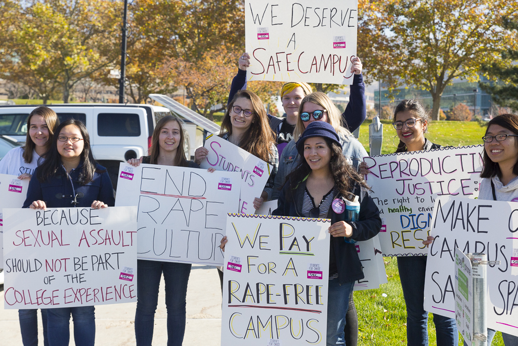 Students for Choice holding their signs during the sexual assault protest in the MEB parking lot on Friday, Nov 4, 2016