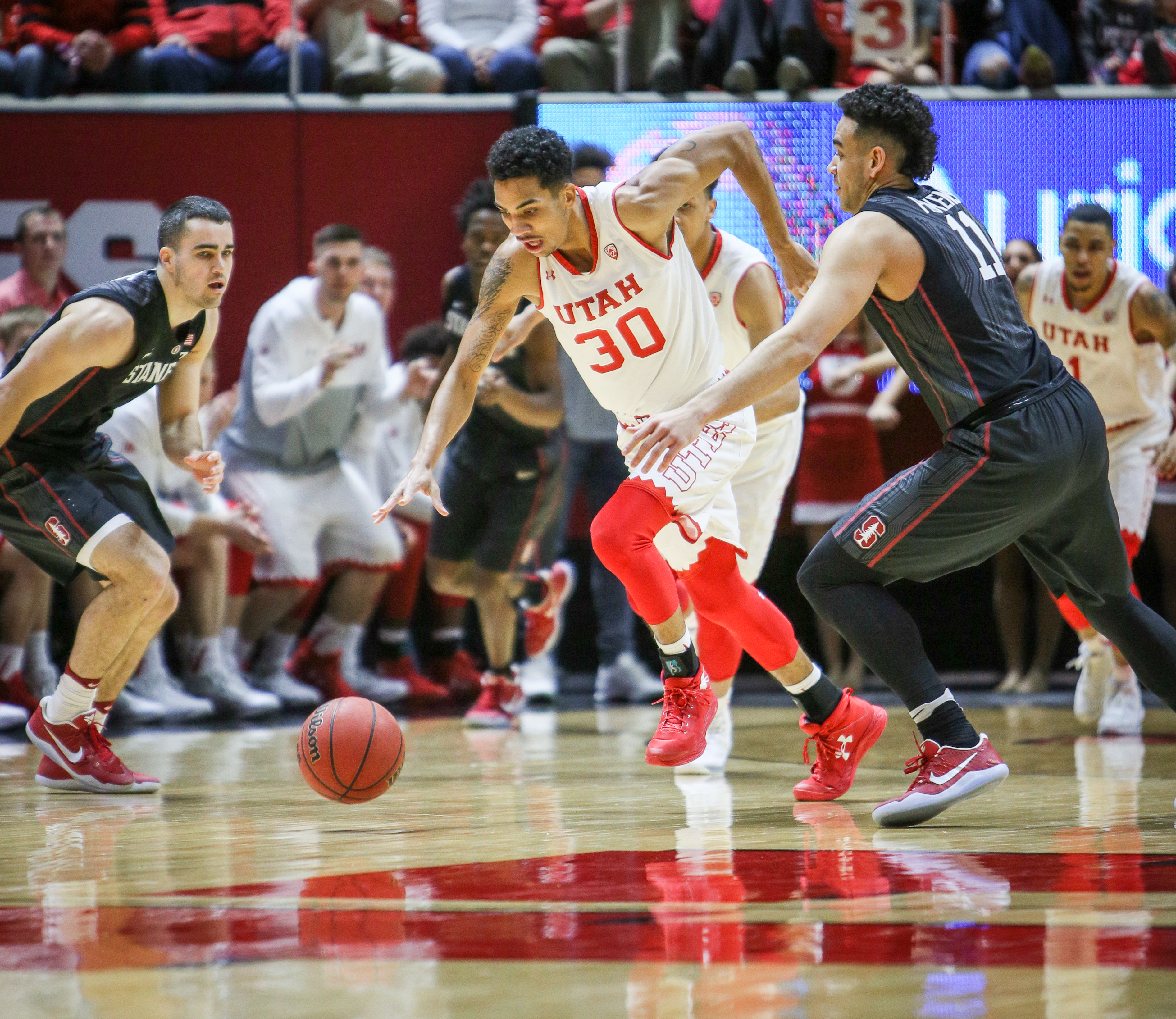 Gabe Bealer dribbling downcourt past the Stanford defense at the Jon Huntsman Center March 4, 2017. Adam Fondren for The Daily Utah Chronicle.