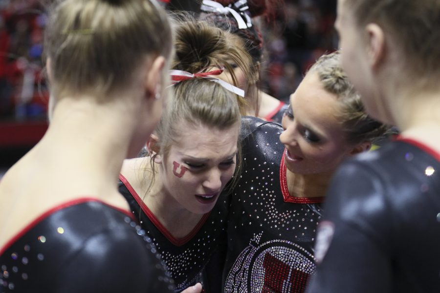 An emotional senior Baely Rowe (center) is embraced after her final beam routine vs Stanford at the Jon M. Huntsman Center on Friday, March 3, 2017. Chris Ayers Daily Utah Chronicle.