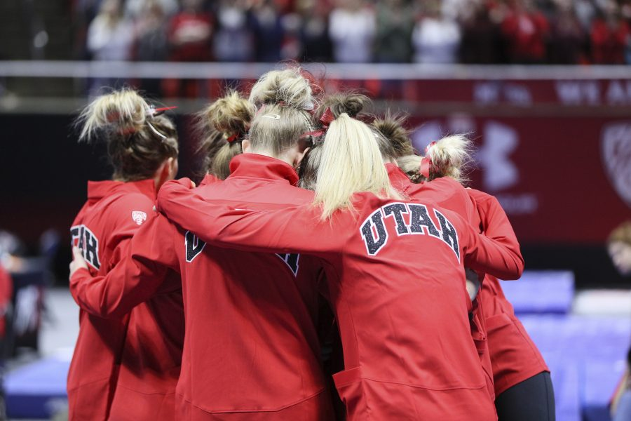 The Red Rocks gather around senior Baely Rowe after her final floor routine vs Stanford at the Jon M. Huntsman Center on Friday, March 3, 2017. Chris Ayers Daily Utah Chronicle.